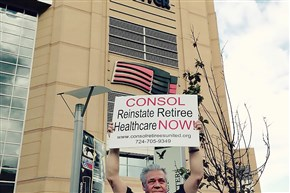 George Kostelnik, a Consol retiree, protested outside the former Consol Energy Center during Stanley Cup playoffs in April 2015.