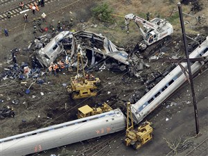 In this May 13, 2015, file photo, emergency personnel work at the scene of the derailment in Philadelphia of an Amtrak train headed to New York.