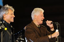 Jon Bon Jovi stands with President Bill Clinton as he greets the crowd at the Get Out The Vote concert in support of Hillary Clinton at Soldiers and Sailors Memorial Hall in Oakland on Thursday.