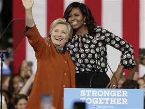 Democratic presidential candidate Hillary Clinton and First Lady Michelle Obama greet supporters during a campaign rally in Winston-Salem, N.C., Thursday.