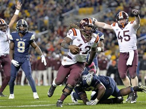 Virginia Tech running back Marshawn Williams scores a touchdown against Pitt in the third quarter.