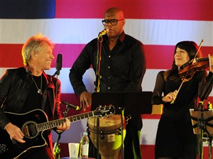 Jon Bon Jovi performs with his band at the Get Out The Vote Concert Thursday.