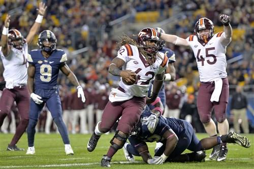 Virginia Tech running back Marshawn Williams scores a touchdown against Pitt in the third quarter.