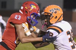 Jeannette's Marcus Barnes (23) faces off with Clairton's Lamont Wade (38) at Jeannette's McKee Stadium last month where Clairton won, 32-13.