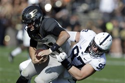 Penn State defensive end Ryan Buchholz sacks Purdue quarterback David Blough during 62-24 Penn State win against Purdue on Oct. 29.