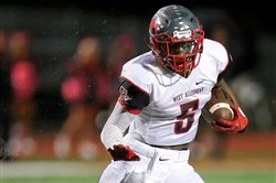 Kenny White of West Allegheny plays against Upper St. Clair last season.