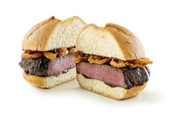 Arby's venison sandwich features a thick-cut. slow-roasted venison steak and crispy onions topped with juniper berry sauce.