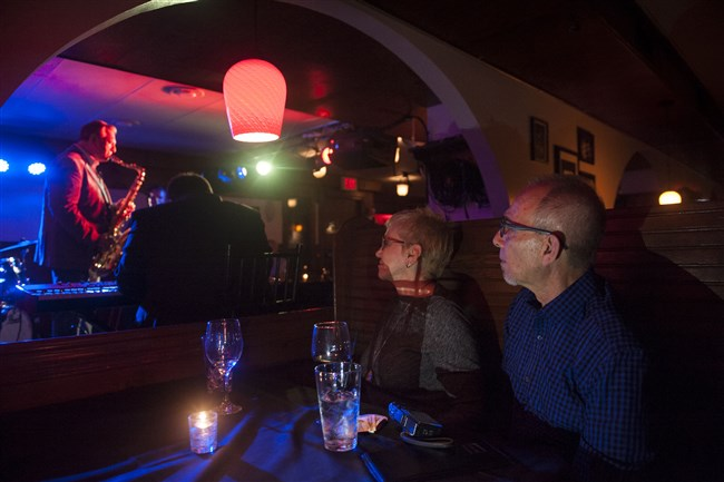 "Dennis Pappalardi, right, and his wife, Judy, of Wexford, listen to jazz during Duquesne University's Jazz Department's ""Collegiate Tuesdays"" at James Street Gastropub and Speakeasy in the North Side in November 2016."