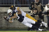Penn State's Mike Gesicki dives forward for extra yardage during last season's game against Iowa.