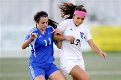 Norwin's Emily Harrigan, right, played a big role in the Knights' PIAA quarterfinal victory.
