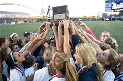 The Norwin girls soccer team raises the trophy to celebrate last season's WPIAL Class 4A title. Norwin returns to the title game again this season, facing Penn-Trafford in the final Saturday at Highmark Stadium.