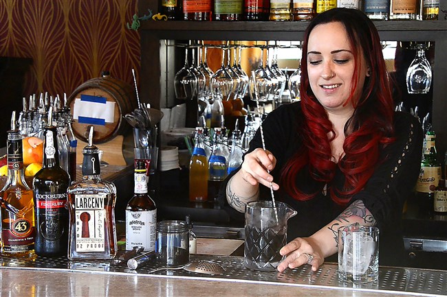 Ariel Scalise creates a cocktail at Tender Bar in Lawrenceville.