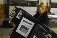 Maryann Baggey of Fineview works to set up voting machines in 2016.