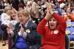 Sylvia Martinelli, of Wilkins Township, and Jeann Topper, of Turtle Creek, cheer as the first results from Pennsylvania come in Tuesday during a watch party at the IBEW hall on the South Side.