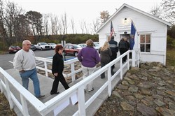 Voters line up outside the Simpson Voting House in Derry Township, Westmoreland County Tuesday morning as it opens at 7:00 a.m. The wood frame building has been used as a voting location since 1891.