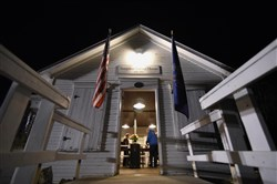 Election workers prepare the Simpson Voting House in Derry Twp., Westmoreland County Nov. 8 before dawn. The wood frame building has been used as a voting location since 1891