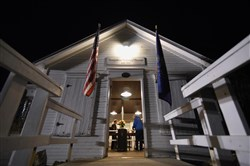 Election workers prepare the Simpson Voting House in Derry Township on Nov. 8 before dawn. The wood frame building has been used as a voting location since 1891.