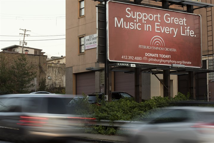 20161111hmnPSOBillboard-3-2 A billboard for the Pittburgh Symphony Orchestra stands Friday in Lawrenceville.