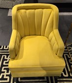 Tobi Fairley for CR Laine did a small channel-backed chair in bright mustard yellow velvet.