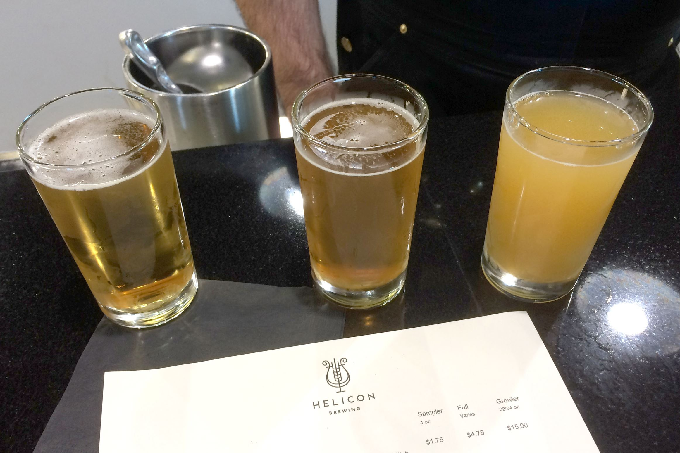 helicon brewing oakdale 03-1 Three 4-ounce sampler glasses of the first beers at Helicon Brewing Co. in Oakdale: From left, Hellen Lager, American Pale Ale 001 and India Pale Ale 002 -- the latter two being the first and second beers ever brewed on Helicon's system.
