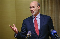 Gov. Tom Wolf said his plan to merge four state departments would streamline -- not cut -- services.