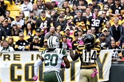 Sammie Coates reaches to pull in a pass for a touchdown against Jets.