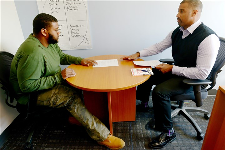 20161115ppPittsburghPromise1LOC-1 Antonio Rosa, Brashear class of 2013, talks with Gene Walker, workplace development director with the Pittsburgh Promise, on Tuesday about a new training initiative offered by the organization.
