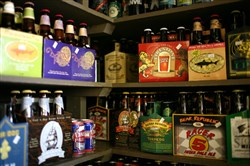 Six packs and single bottles of beer are displayed on a shelf at the City Beer Store in San Francisco.
