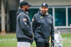 Mike Tomlin talks to Todd Haley during practice last month at the Steelers' South Side training facility.