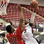 Duquesne's Tarin Smith finished over top of Saint Francis' Josh Nebo in the first half Wednesday at Palumbo Center.