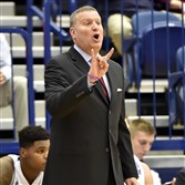 Duquesne head coach Jim Ferry calls out a play as his team takes on Saint Francis in the first half Wednesday night at Palumbo Center.