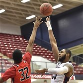 Duquesne's Darius Lewis puts up a shot Wednesday night against Saint Francis at Palumbo Center.
