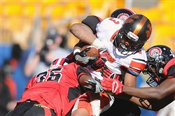 Malik Shepherd is tackled as a member of Beaver Falls' football team.