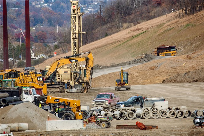 In this Nov. 14, 2016 file photo, workers prepare the site of a multi-billion dollar ethane cracker complex that Shell is building in Potter and Center townships in Beaver County. A 97-mile pipeline is planned to carry ethane, a natural gas liquid, from points in Ohio and Washington County to the new cracker plant.