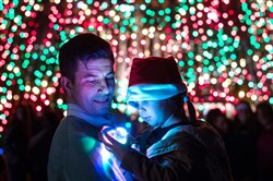 Bob Doddato of North Fayette holds his daughter, Jovie, 4, as she takes in the lights at Point State Park during her first Comcast Light Up Night in 2016.