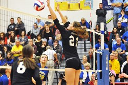 Greensburg Central Catholic senior Mikayla Bisignani sets up a block Saturday in the PIAA Class 1A final.