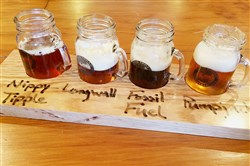 A flight of all four beers being served last weekend at the new Coal Tipple Brewery near Burgettstown, Washington County.  From left, Nippy Tipple ale, Longwall India pale ale, Fossil Fuel stout and Pumpjack spiced ale, served rimmed with spices and sugar. Flights are priced at $7 and pints at $4.