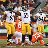 Arthur Moats celebrates after sacking Browns quarterback Josh McCown on Sunday.