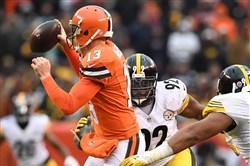 Pittsburgh Steelers James Harrison sacks Browns quarterback Josh McCown at First Energy Stadium in Cleveland.