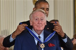 President Barack Obama presents sports broadcaster Vin Scully with the Presidential Medal of Freedom on Tuesday.
