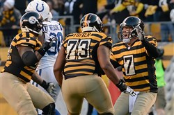 Ben Roethlisberger, right, Ramon Foster, center, and Maurkice Pouncey celebrate Roethlisberger's TD pass to Antonio Brown against the Colts in 2014.