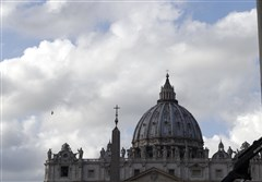 Clouds pass over St. Peter's Basilica at the Vatican