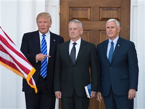 In a photo taken Nov. 19, President-elect Donald Trump stands with retired Marine Gen. James Mattis, center, and Vice President-elect Mike Pence on the steps of the clubhouse at Trump National Golf Club in Bedminster, New Jersey.