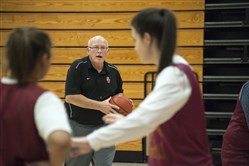 Serra Catholic girls basketball coach, Bill Cleary works with his team in practice Tuesday.