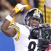 Antonio Brown mugs for the camera after scoring late in the fourth quarter against the Colts at Lucas Oil Stadium.