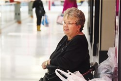 Brenda Beetlestone of Clairton takes a break at Monroeville Mall. More Americans shopped on Black Friday this year, according to a Gallup poll.