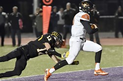 Erie Cathedral Prep's Joseph Mischler runs into the end zone for a touchdown against Thomas Jefferson's Garret Fairman in a PIAA Class 4A playoff game Friday at Baldwin High School.