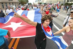 People take to the streets in Miami as they react to the news of the death of former Cuban President Fidel Castro.