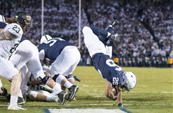 Penn State running back Saquon Barkley flips into the end zone for a touchdown during the second quarter against Michigan State on Saturday at Beaver Stadium in University Park, Pa.