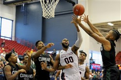 Duquesne's Darius Lewis tries to grab a rebound from Cleveland State players Sunday at Palumbo Center, where the Dukes emerged victorious but not without glaring issues.